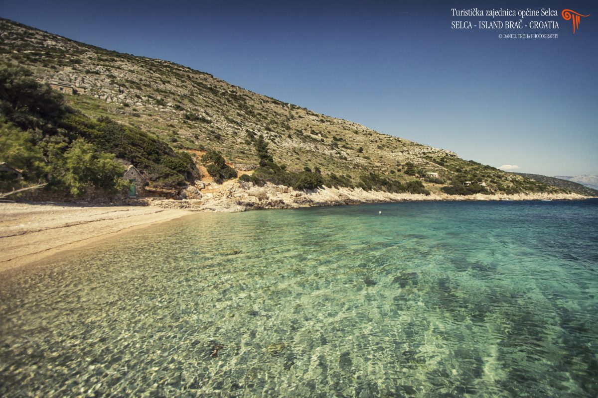 Crystal clear sea water in front of pebble beach on the island of Brac