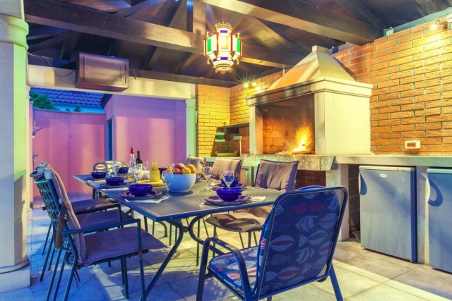 Dinner time at the covered outdoor area with open fireplace